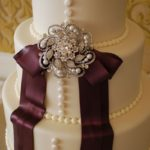 Fondant with Buttons, Bow, and Brooch