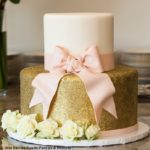 gold disco dust rolled fondant with base border and bow